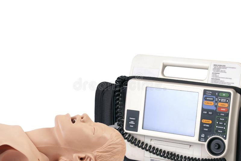 Concepto del entrenamiento del param?dico, curso de los primeros auxilios Defibrillator del AED y un maniqu? del entrenamiento de imagenes de archivo