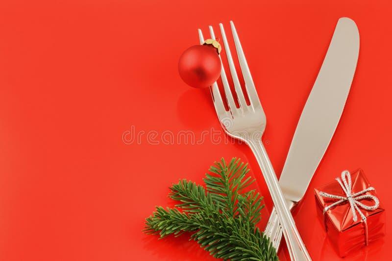 Concepto del menú de la Navidad sobre fondo rojo fotografía de archivo libre de regalías