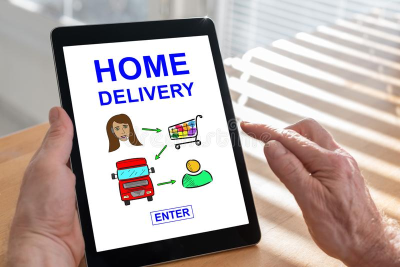 Concepto del servicio a domicilio en una tableta imágenes de archivo libres de regalías