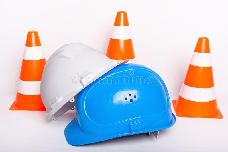 Concepto del solar del cono del constructor de los cascos de seguridad fotografía de archivo
