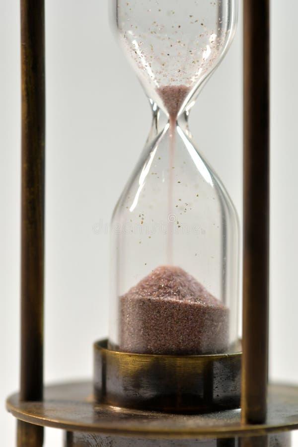 Concepto del tiempo con reloj de arena imagen de archivo