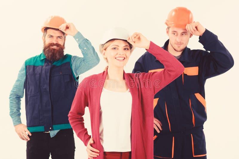 Concepto del trabajo de las personas Constructor, ingeniero, trabajador, reparador como equipo amistoso imagenes de archivo