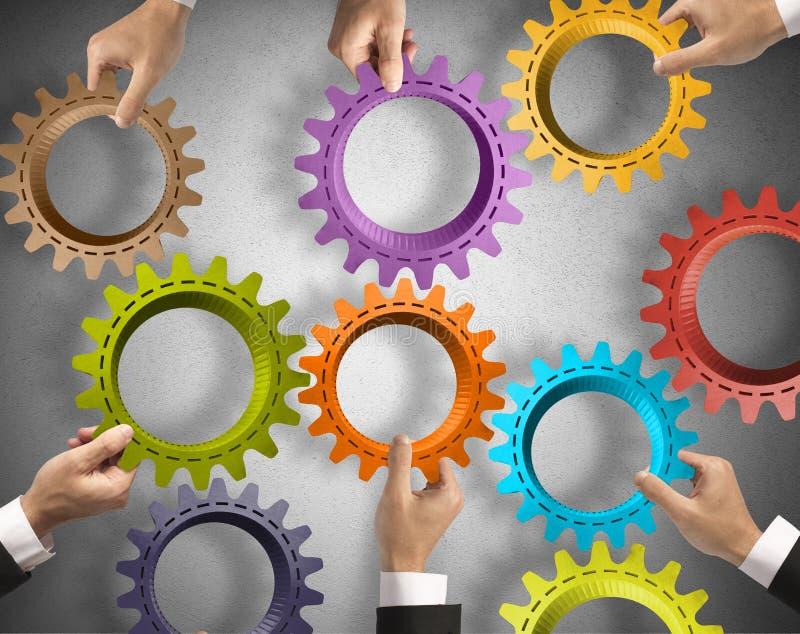 Concepto del trabajo en equipo y de la integración foto de archivo
