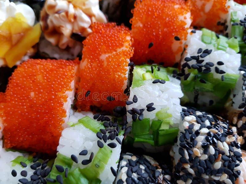 Concepto determinado fresco de la comida de los rollos de sushi foto de archivo libre de regalías