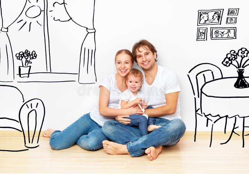 Concepto: familia joven feliz en nuevo interior del sueño y del plan del apartamento imágenes de archivo libres de regalías