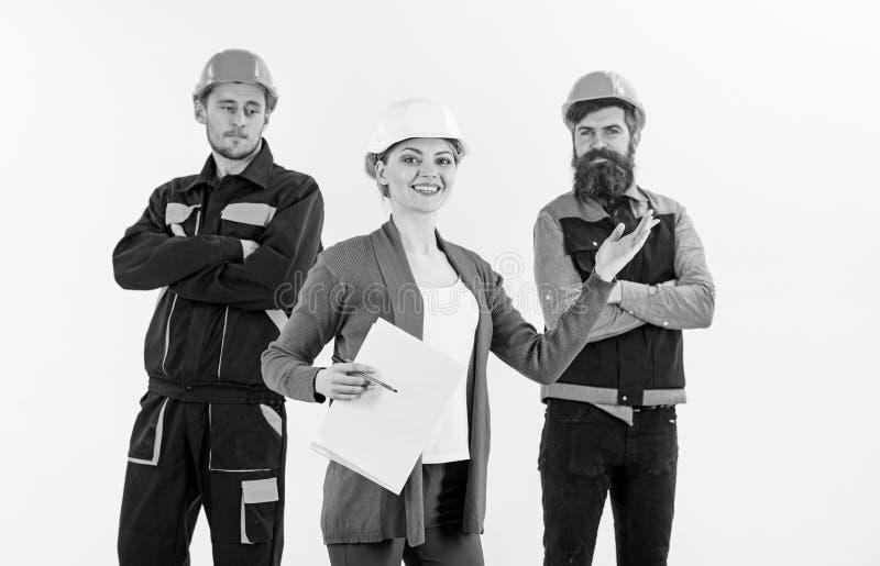 Concepto femenino del jefe Equipo de los arquitectos, constructores con la mujer imagen de archivo