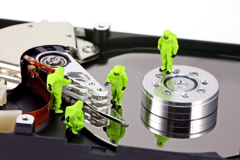 Concepto: HAZMAT quitan el virus imagenes de archivo