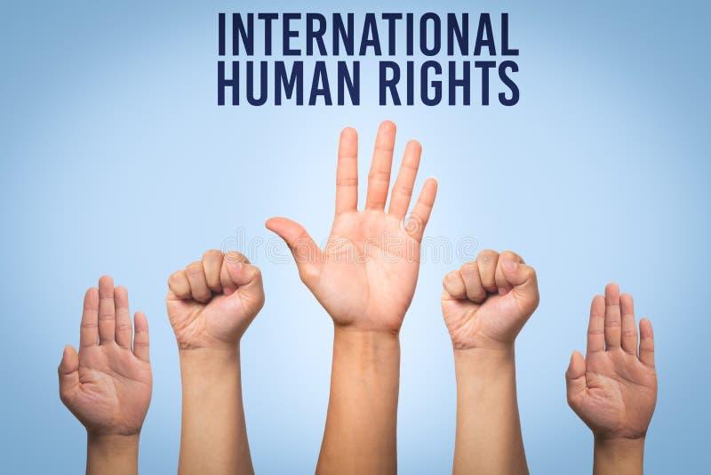Concepto internacional del día de los derechos humanos, mano del aumento para arriba imagen de archivo