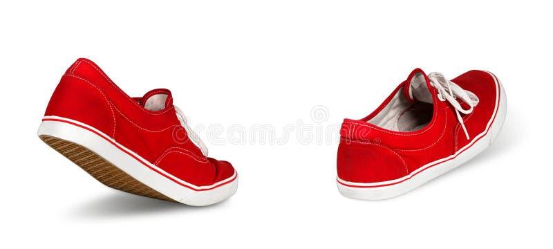 Concepto que camina de los zapatos rojos vacíos imagen de archivo