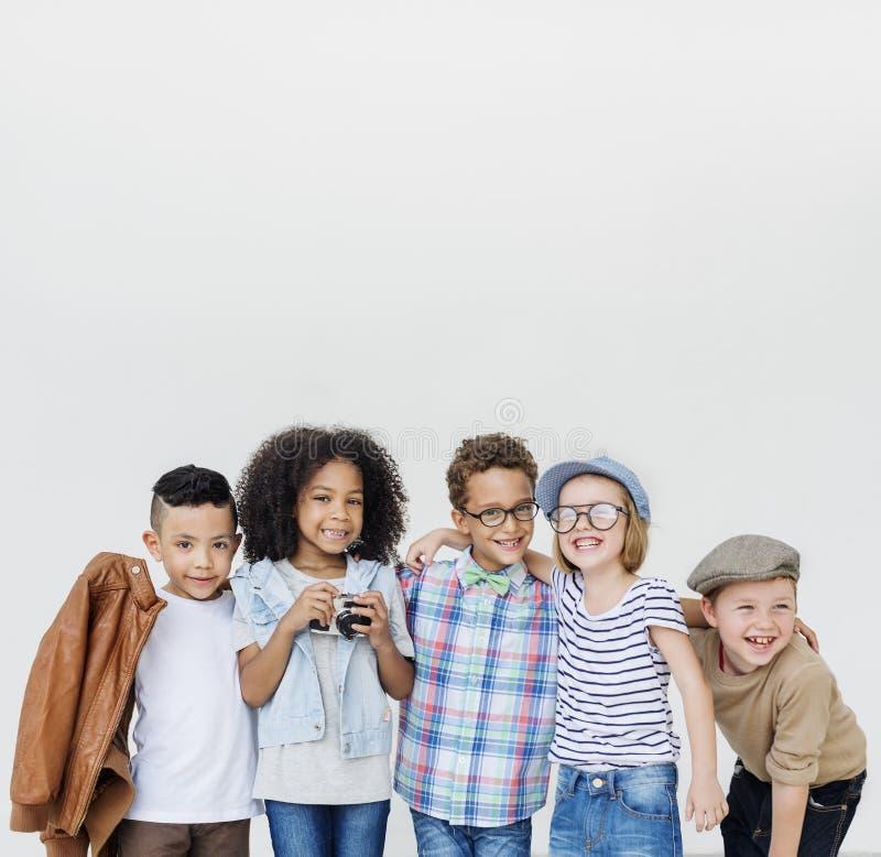 Concepto retro de la unidad de la felicidad juguetona de los niños de la diversión de los niños foto de archivo libre de regalías