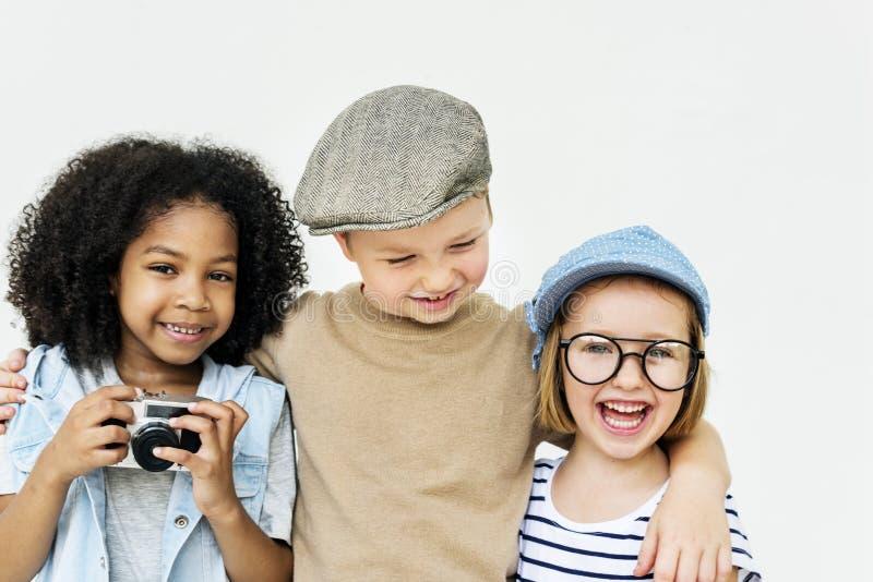 Concepto retro de la unidad de la felicidad juguetona de los niños de la diversión de los niños imágenes de archivo libres de regalías