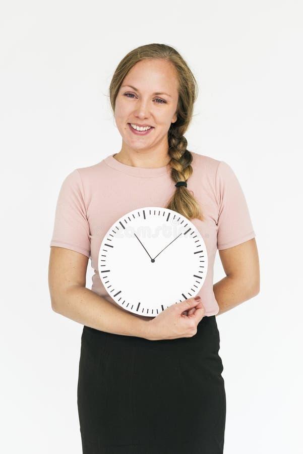 Concepto sonriente del retrato de la gestión de tiempo de la felicidad de la mujer imagenes de archivo