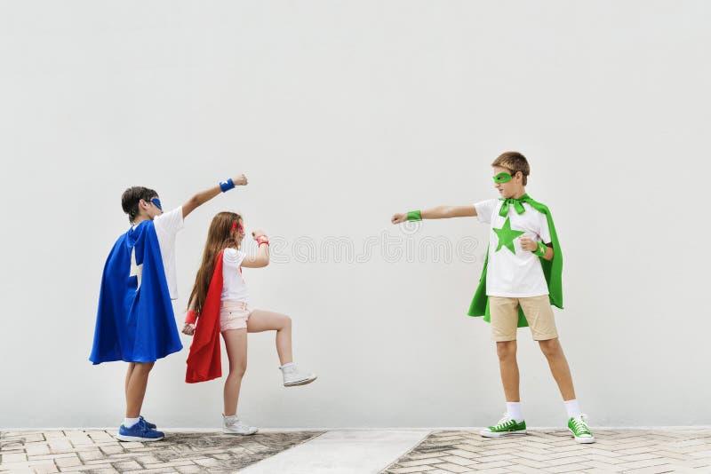 Concepto valiente de la imaginación de la muchacha del muchacho del super héroe fotos de archivo libres de regalías