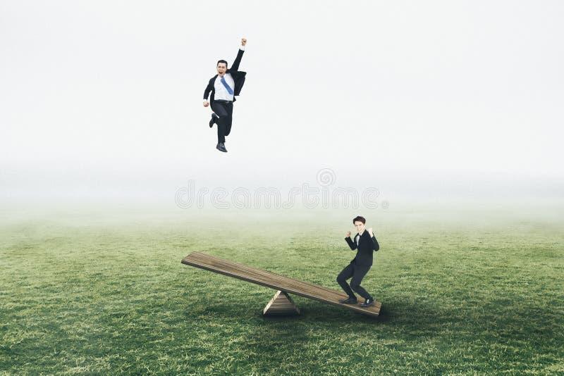 Conceptos de salto y que vuelan del hombre de negocios joven foto de archivo libre de regalías
