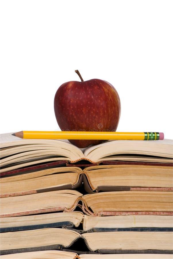 Concepts éducatifs (livres ouverts w/apple) photographie stock