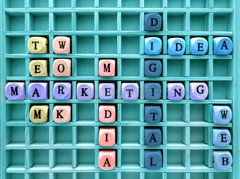 Concepts of communication digital marketing formed with wood cub. Words of business marketing concepts made with letters from a set of wooden cubes . Concepts of stock photography
