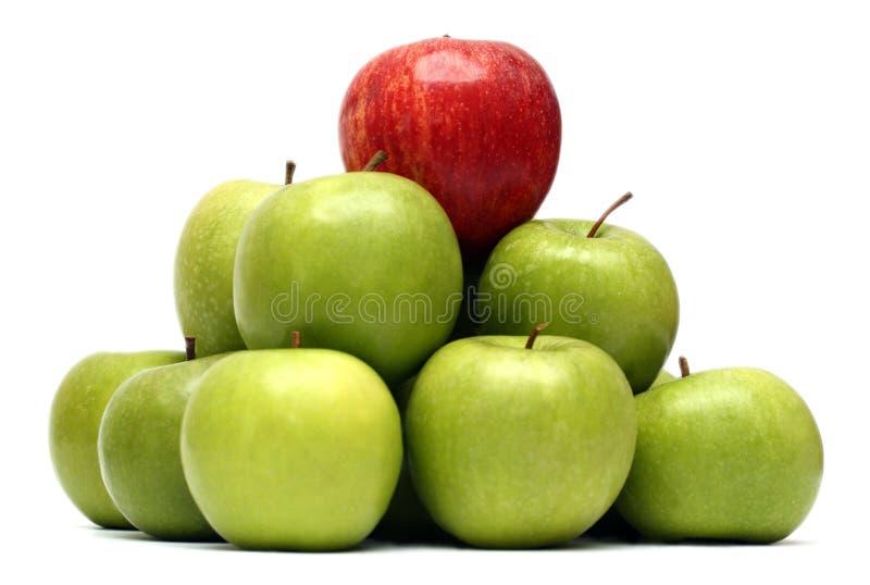 Concepts de domination avec des pommes images stock