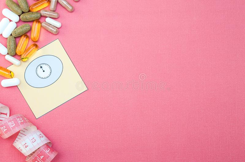 Concepts of dietary supplements for weight loss, centimeter and scales, healthy product  concept close up, stock image