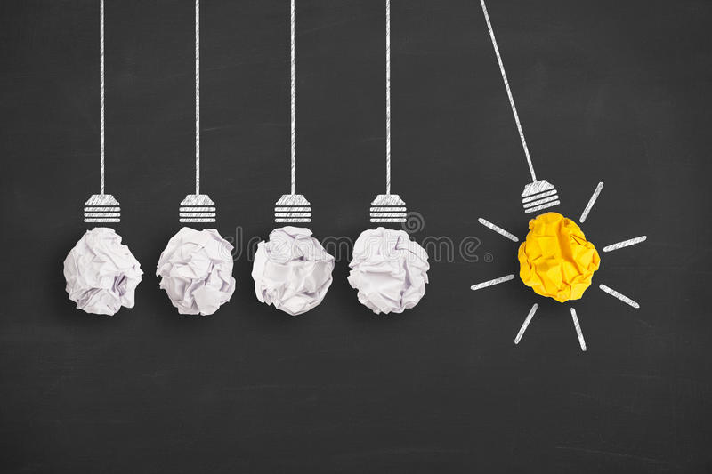 Concepts of innovation with light bulb on chalkboard background royalty free stock photo