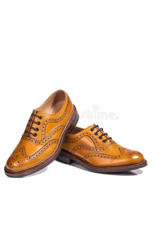 Closeup of A Pair of Full Broggued Tan Leather Oxfords Shoes. Concepts of Luxury Male Footwear. Closeup of A Pair of Full Broggued Tan Leather Oxfords Shoes royalty free stock photography
