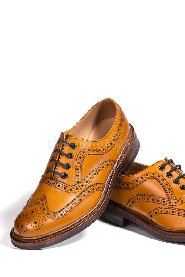 Luxury Male Footwear. Partial Closeup of A Pair of Full Broggued Tan Leather Oxfords Shoes. Concepts of Luxury Male Footwear. Partial Closeup of A Pair of Full stock images