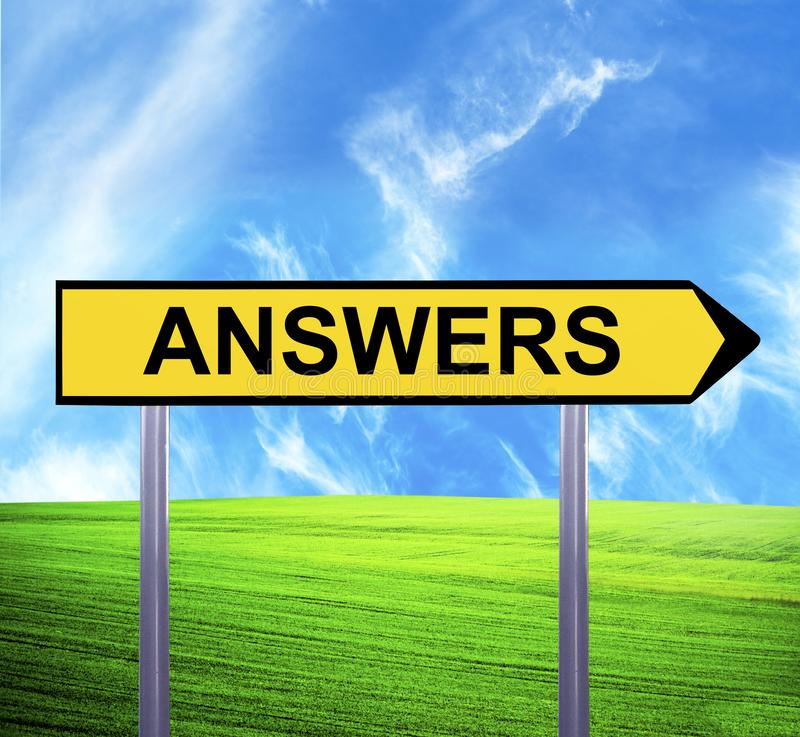 Conceptual arrow sign against beautiful landscape with text - ANSWERS stock photo