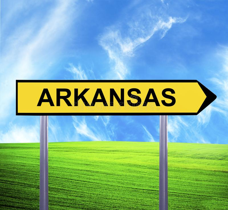 Conceptual arrow sign against beautiful landscape with text - ARKANSAS royalty free stock photography