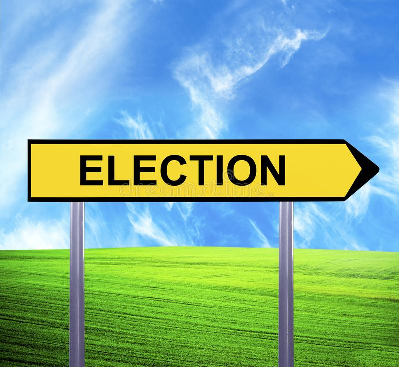 Conceptual arrow sign against beautiful landscape with text - ELECTION royalty free stock photography