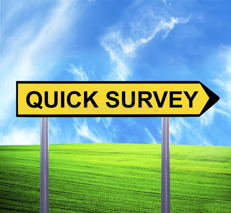 Conceptual arrow sign against beautiful landscape with text - QUICK SURVEY stock photography