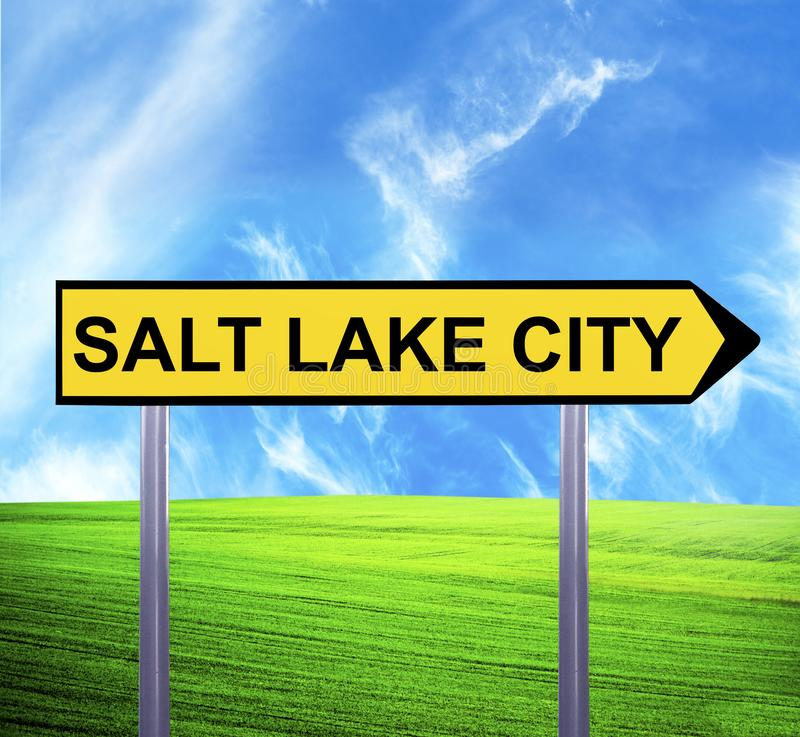 Conceptual arrow sign against beautiful landscape with text - SALT LAKE CITY royalty free stock photos