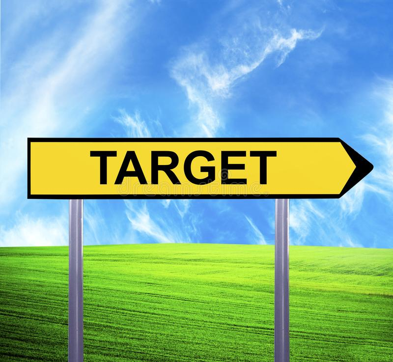 Conceptual arrow sign against beautiful landscape with text - TARGET stock photography