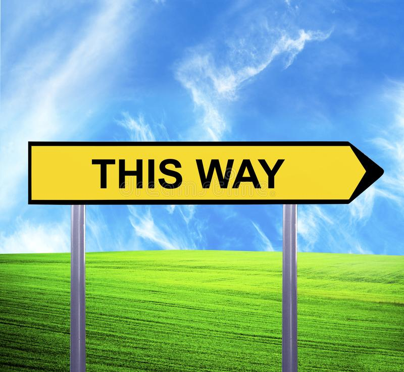 Conceptual arrow sign against beautiful landscape with text - THIS WAY royalty free stock photos