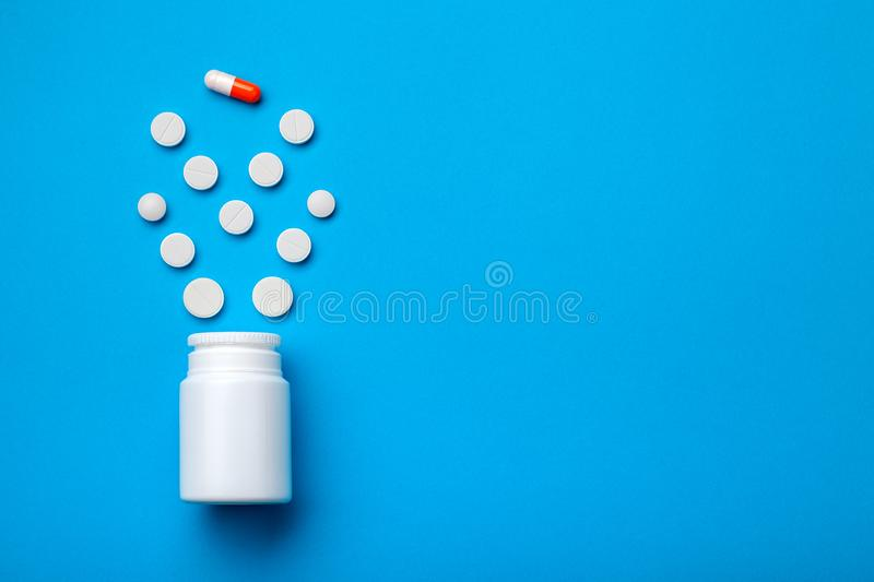 Conceptual background with pills and capsule. royalty free stock image