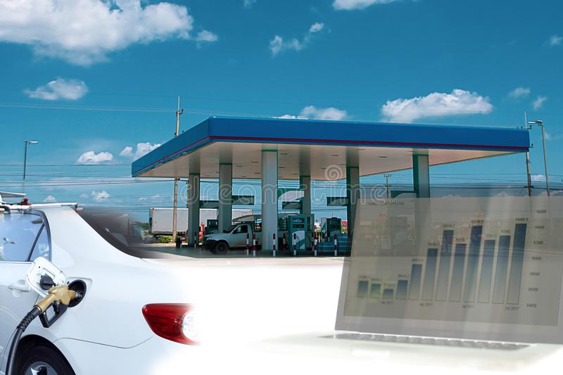 Conceptual business financial double exposure of gas station and cars with stock money chart. stock images