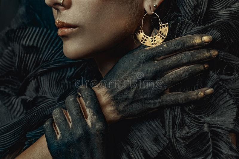 Conceptual close up portrait of beautiful fashion look woman dar. K make up stock photo
