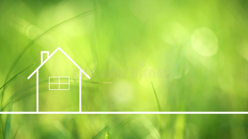 Conceptual eco home healthy living. Conceptual eco friendly home healthy living copy space background on blurred sunny meadow texture royalty free stock image