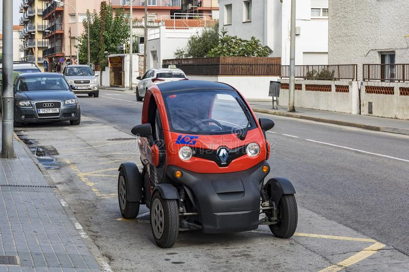 Conceptual electric car parked on city street. Spain, Blanes - 25.09.2017: Unusual conceptual electric car parked on the city street stock images