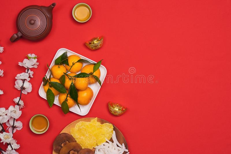 Conceptual flat lay Chinese New Year food and drink still life. royalty free stock photography