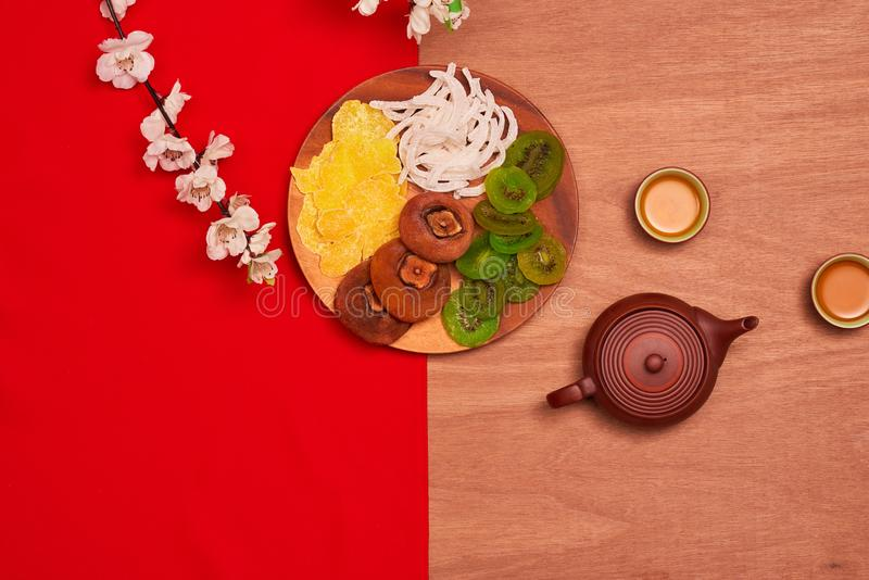 Conceptual flat lay Chinese New Year food and drink still life. royalty free stock photos