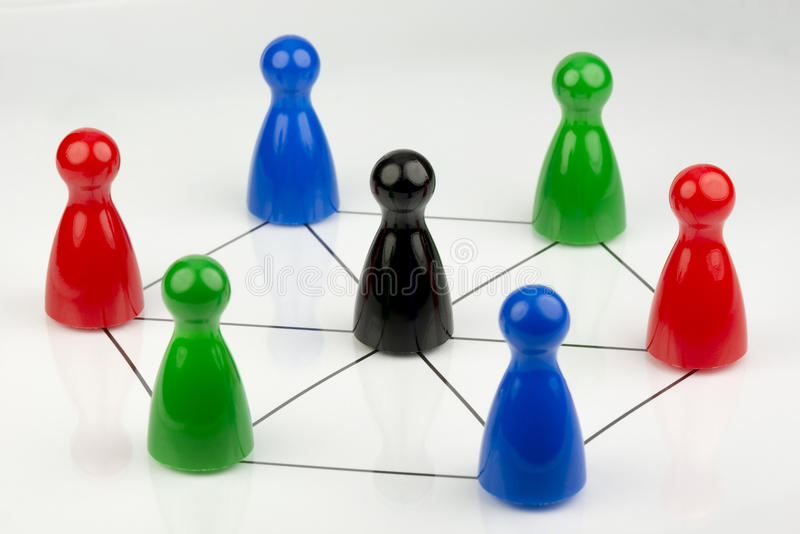 Conceptual game pawns. That depict the concept networks and work together stock image