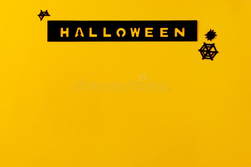 Conceptual halloween layout on a yellow-orange background. Hand made scrapbooking inscription royalty free stock photos