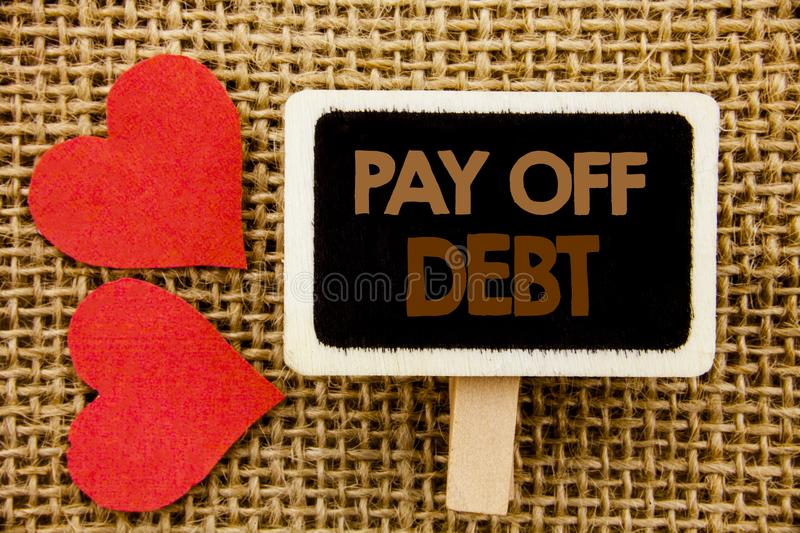 Conceptual hand text showing Pay Off Debt. Business photo showcasing Reminder To Paying Owed Financial Credit Loan Bills written o. Conceptual hand text showing stock images