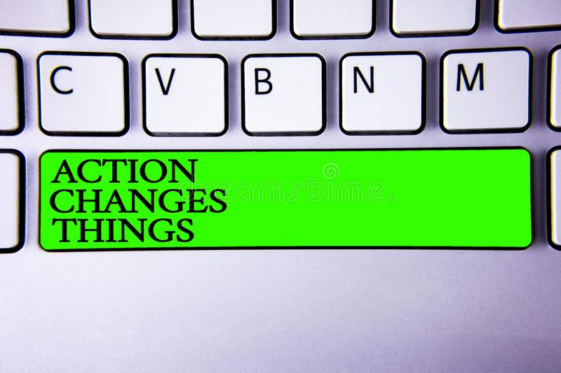 Conceptual hand writing showing Action Changes Things. Business photo showcasing improve yourself Do not stand still Let s do it. Spacebar laptop keyboard white royalty free stock photos