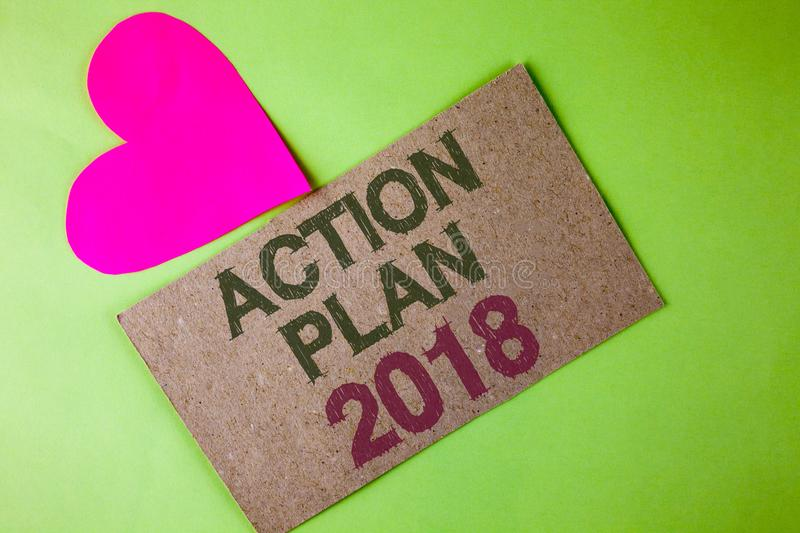 Conceptual hand writing showing Action Plan 2018. Business photo text to do list in new year New year resolution goals Targets wri. Tten Cardboard Piece the royalty free stock image