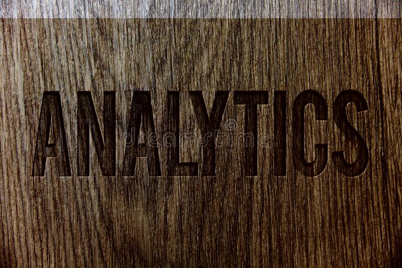 Conceptual hand writing showing Analytics. Business photo showcasing Data Analysis Financial Information Statistics Report Dashboa. Rd Wooden background vintage stock photography