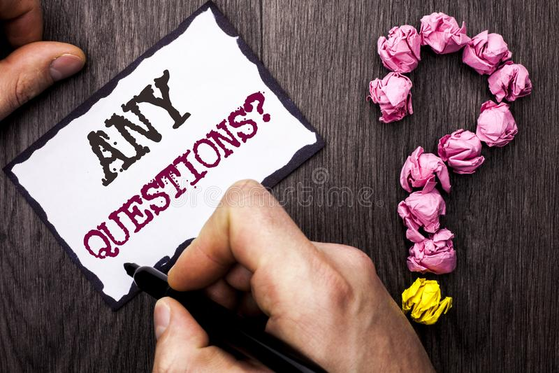 Conceptual hand writing showing Any Questions Question. Business photo text Need to ask something Extra Information Wanted written. By Man Sticky Note Holding royalty free stock photos