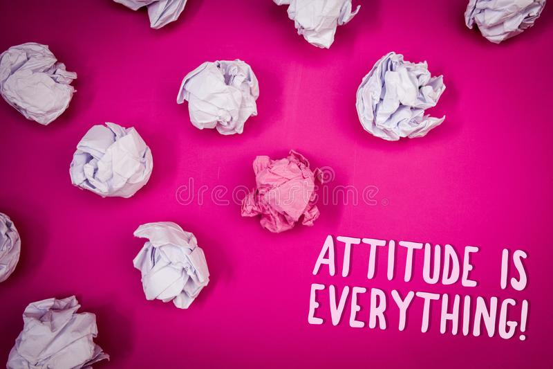 Conceptual hand writing showing Attitude Is Everything. Business photo text Personal Outlook Perspective Orientation Behavior Idea. S pink background crumpled stock photo