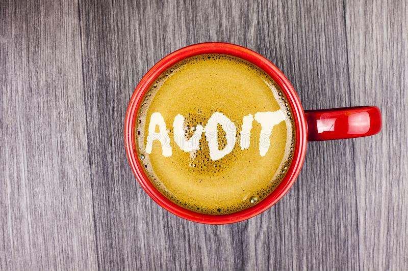 Conceptual hand writing showing Audit. Business photo text Local company auditors perform their financial investigation annually w. Ritten Coffee in Red Cup Grey stock photo