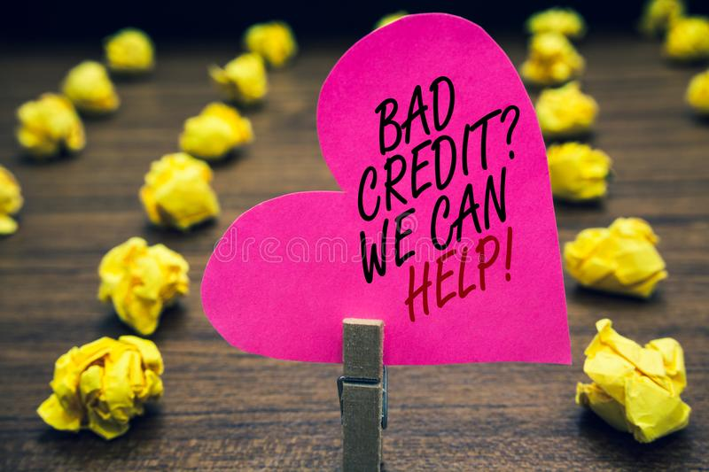 Conceptual hand writing showing Bad Credit question We Can Help. Business photo text Borrower with high risk Debts Financial Paper. Clip hold pink written heart stock image