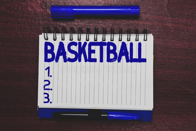 Conceptual hand writing showing Basketball. Business photo text Sport Indoors court game Competition throw ball to open. Net Open notebook page marker royalty free stock photography